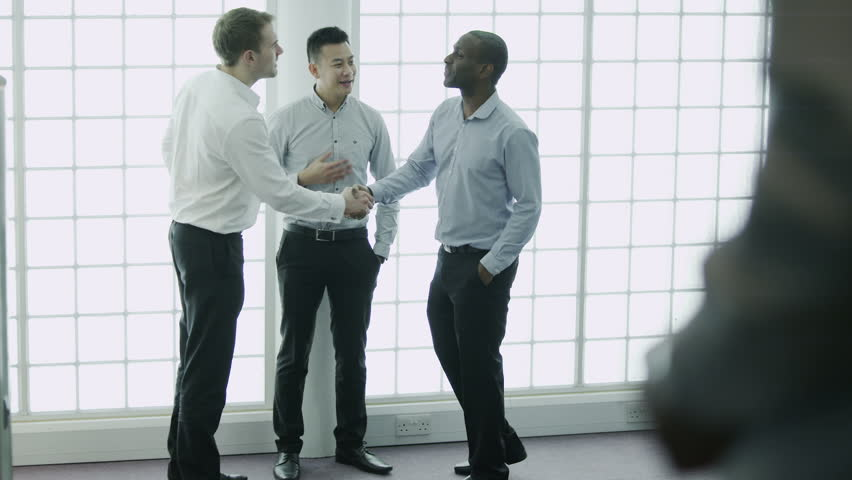 Informal business group taking a break from work and chatting together. In slow motion. | Shutterstock HD Video #4363259