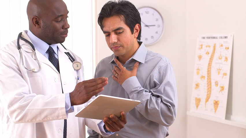African American doctor using tablet pc with Hispanic patient | Shutterstock HD Video #4378274