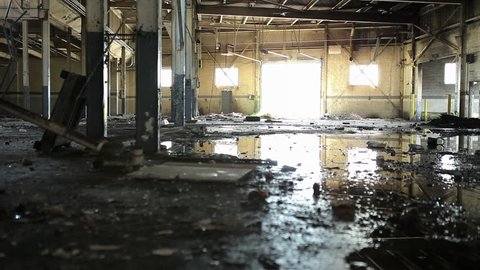Abandoned Factory in Bankrupt Detroit Blight Collapse Burnout Arson Fire Reflection Puddle