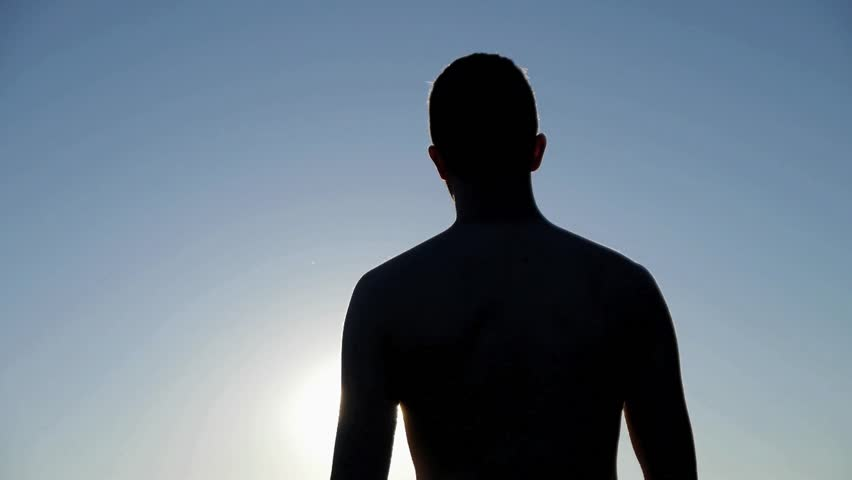 Unfocused Backlit Naked Man Walking Towards A White Light -2123