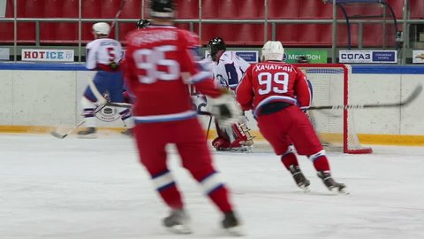 MOSCOW - APR 28: Hockey teams play near gate during match on closing ceremony of championship season of 2011-2012 Ice Hockey for Sports School in Sokolniki on 28 April 2012, Moscow, Russia