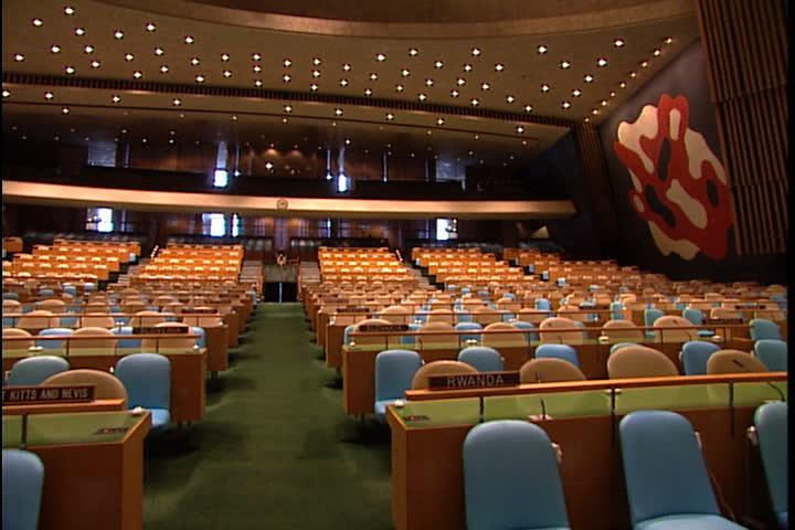 NEW YORK CITY - FEBRUARY 11, 1999: Whip pan around the inside of the United Nations General Assembly hall.