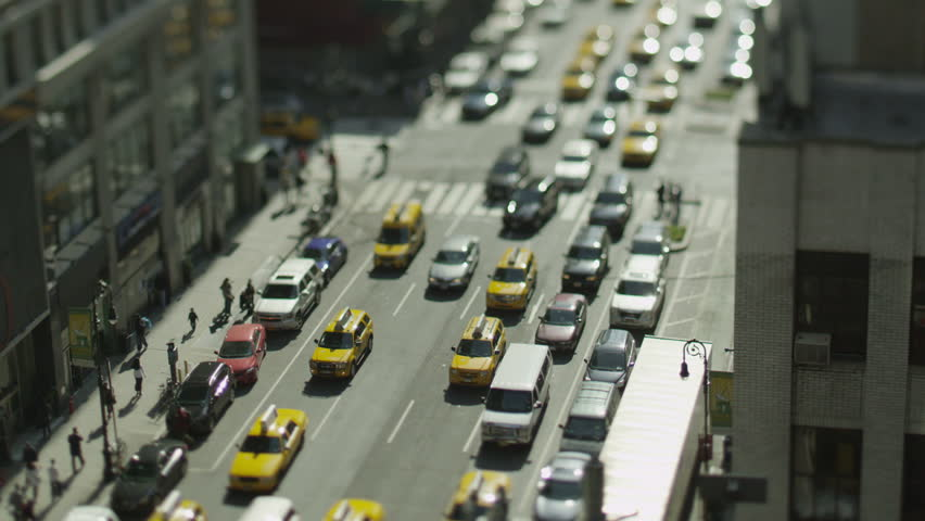 Overhead view of traffic in New York on a bright morning. In slow motion.