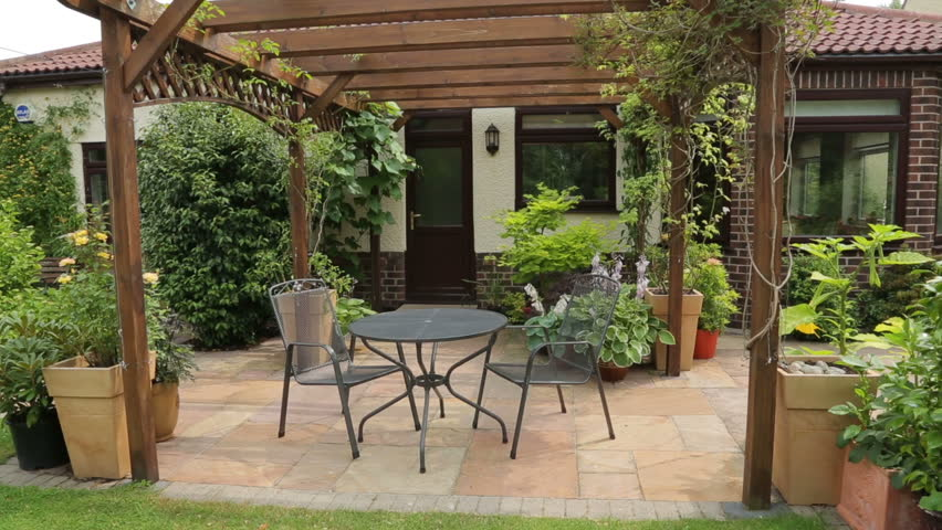 Delightful Home Patio With Pergola And Table And Chairs   HD Stock Video Clip