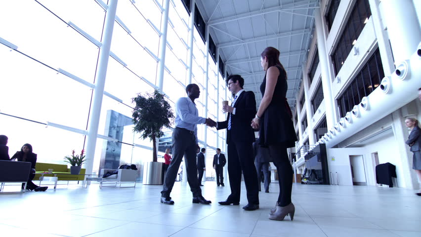 Large office team time lapse. People shaking hands in office foyer reception. | Shutterstock HD Video #4479419