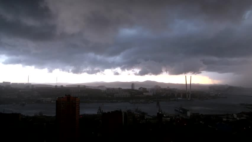 Townscape with rain clouds. Rain clouds over the city of Vladivostok.