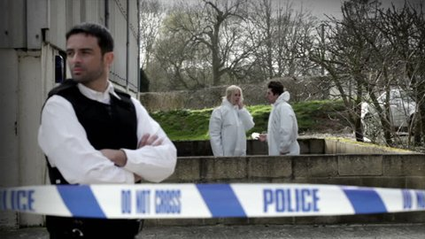 Forensic search and police officers at work
