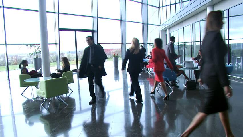 Business people inside a modern office building | Shutterstock HD Video #4522715
