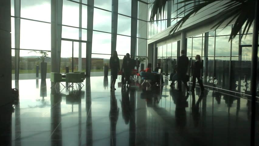 Overhead shot of business people inside a modern office building | Shutterstock HD Video #4523045