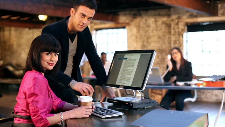 Small creative business and team working in casual chic downtown loft office.  | Shutterstock HD Video #4525379