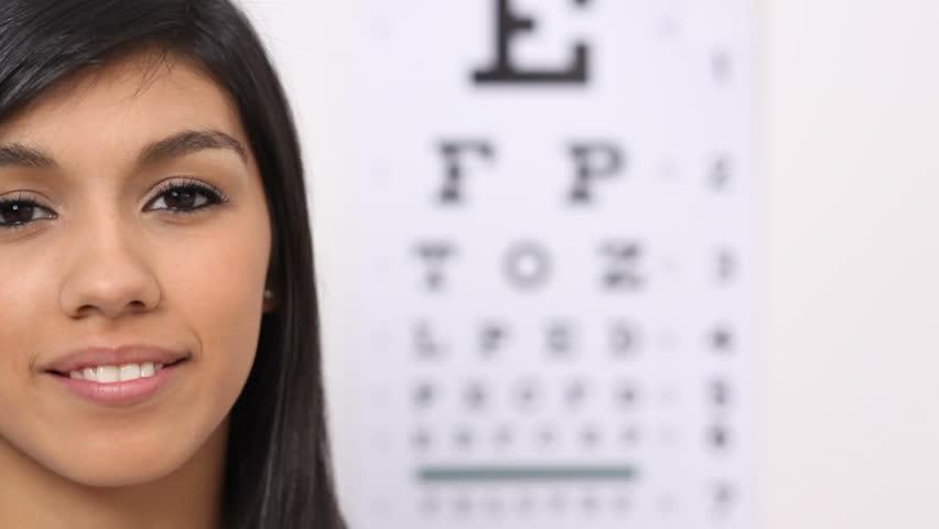 Woman puts on glasses
