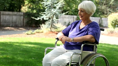 Woman in wheelchair with grandchildren