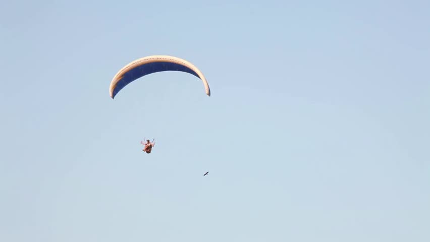 Paraglider in sky.