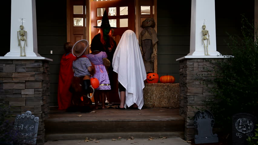 Children in Halloween costumes trick or treating | Shutterstock HD Video #4559180