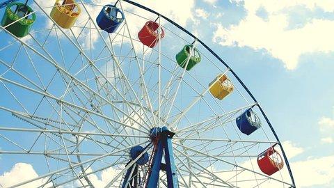 Underside view of a ferris wheel over blue sky