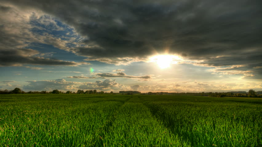 Sunset over green fields, HD time lapse clip, high dynamic range imaging