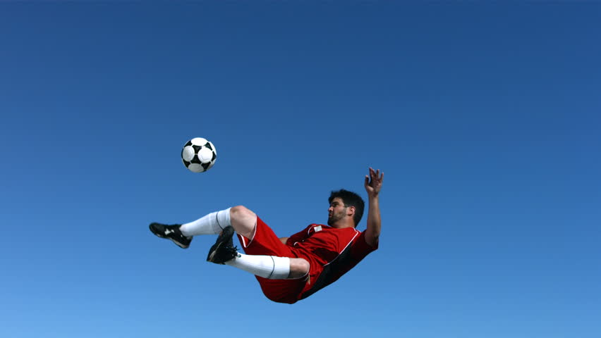 Soccer player kicking ball in mid-air, slow motion | Shutterstock HD Video #4579049
