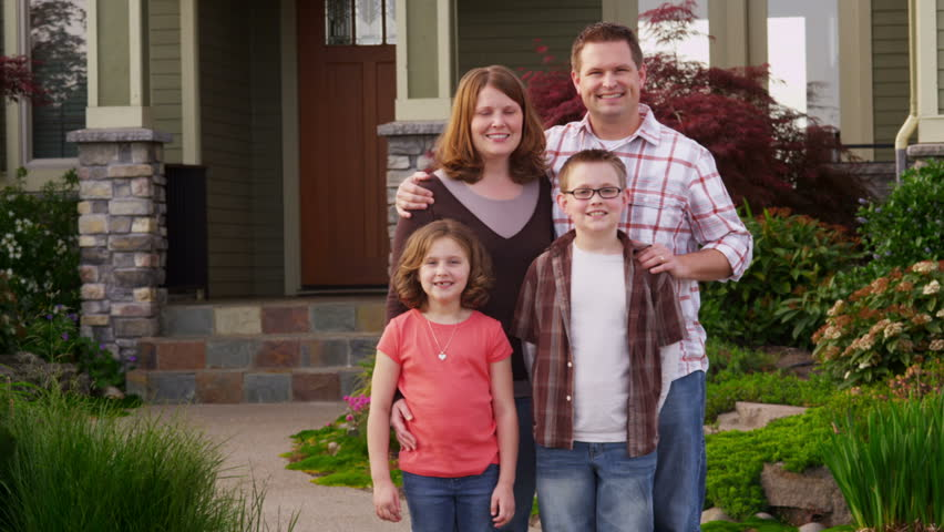 Family portrait in front of home