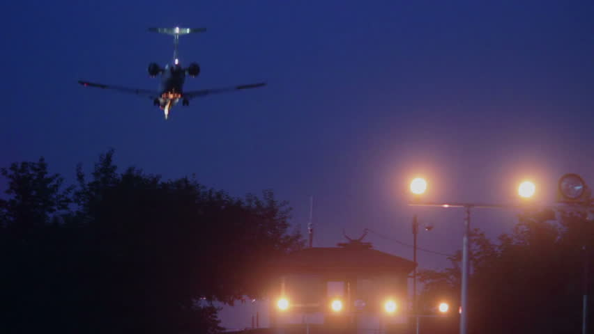 Airliner landing at night, signal lights
