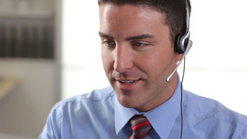 Customer service person talking on headset in office | Shutterstock HD Video #4588799