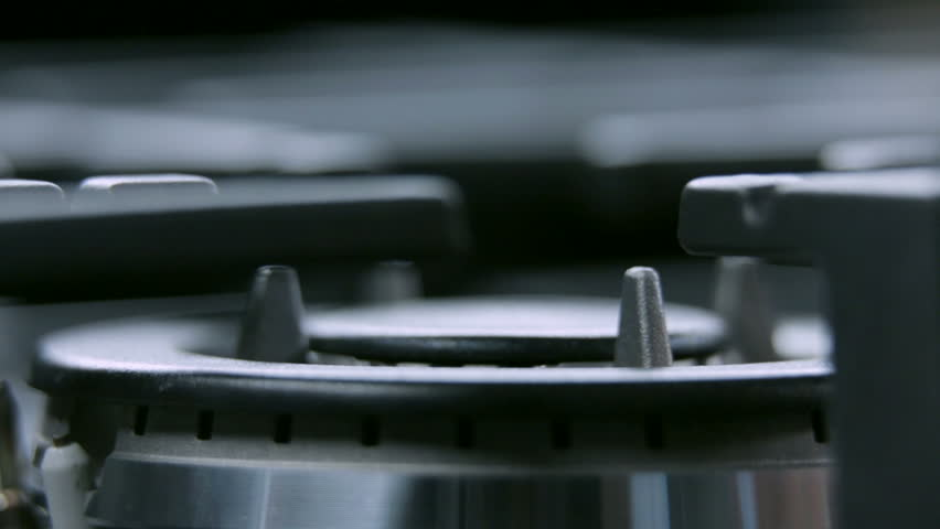 Gas cooker cooktop from close up turning on