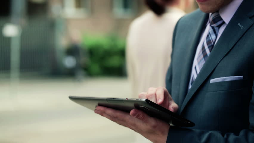 Businessman working on tablet computer by the street  | Shutterstock HD Video #4612673
