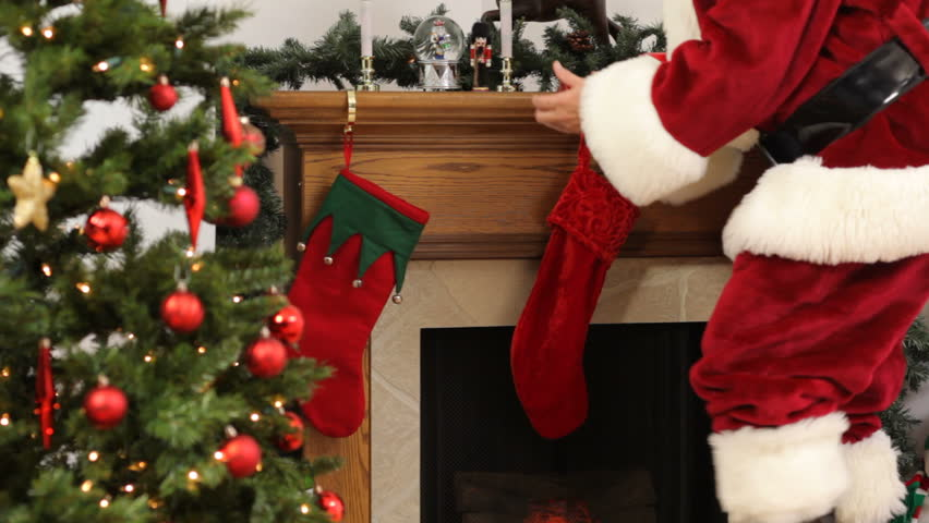 a1626da49 Santa Claus Fills Christmas Stockings Stock Footage Video (100 ...