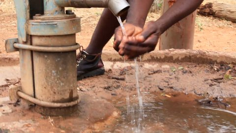 African man getting water at bore hole
