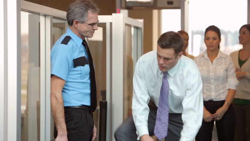 Businessman is inspected by airport security