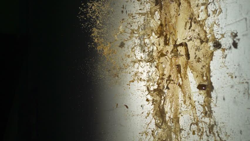 Smashing beer bottle against wall shooting with high speed camera, phantom flex.