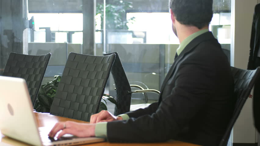 Two young business professionals meet up in a conference room. Medium shot   Shutterstock HD Video #4632803