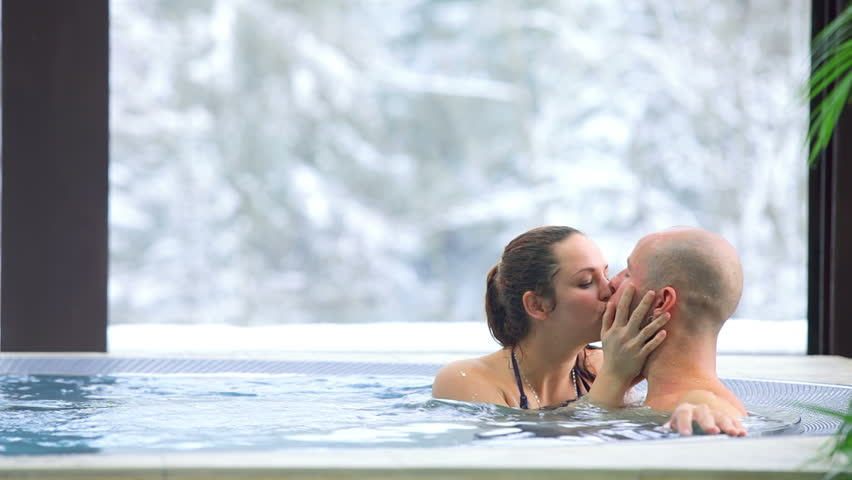 Cute young adults kiss in hot tub #4632989