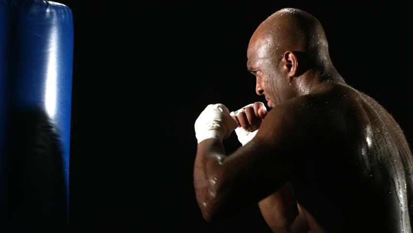Boxer hits punching bag
