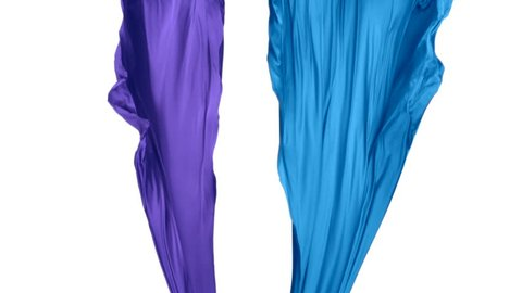 Blue and purple fabric flowing in the air on white background shooting with high speed camera, phantom flex.