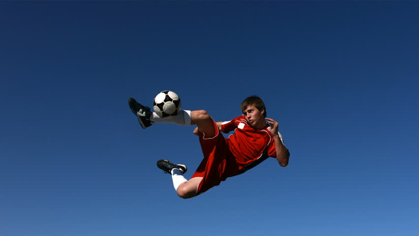 Soccer player kicking ball in mid-air, slow motion | Shutterstock HD Video #4656179