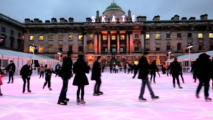 London - February 2011: Daytime ice skating scene on the ice rink at Somerset House in the city of London, United Kingdom, February, 2011