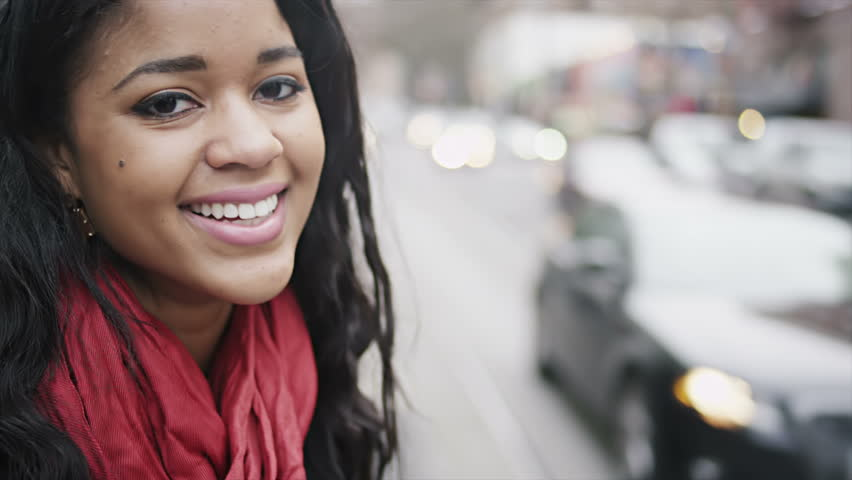 A beautiful young woman looks around and then looks into the camera and smiles. Close up shot. | Shutterstock HD Video #4663499