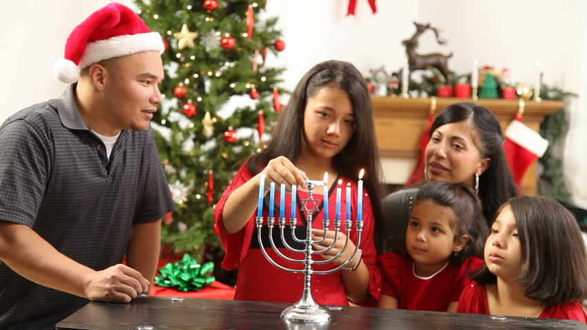 Hispanic Family Together Lighting Menorah At Christmas Stock Footage Video 4665299
