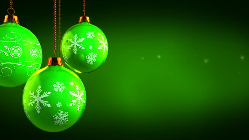 stock video of christmas ornaments on green background
