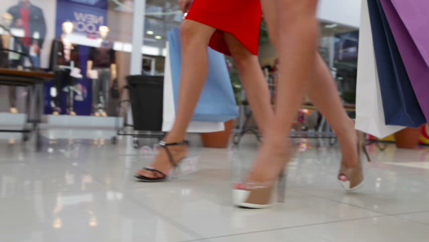 Close-up of shopping girls marching in the mall | Shutterstock Video #4685174