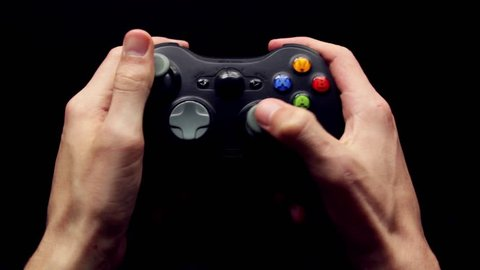 A gamer plays Xbox on a wireless controller.