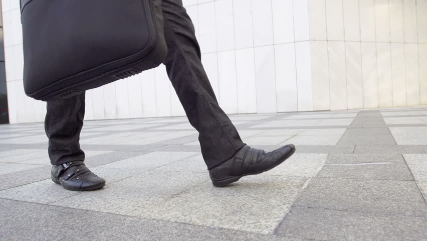 Slow Motion Shot Of A Casually Dressed Male Legs Walking.