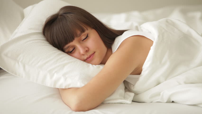 Cute girl sleeping in bed opening her eyes and smiling | Shutterstock HD Video #4695209