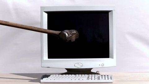 Smashing a computer with sledge hammer
