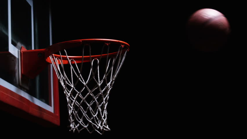 Close Up Of A Basketball Falling Through The Net Of The ...