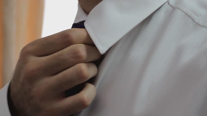 d95195afd3be Groom Tying His Tie Preparing Stock Footage Video (100% Royalty ...