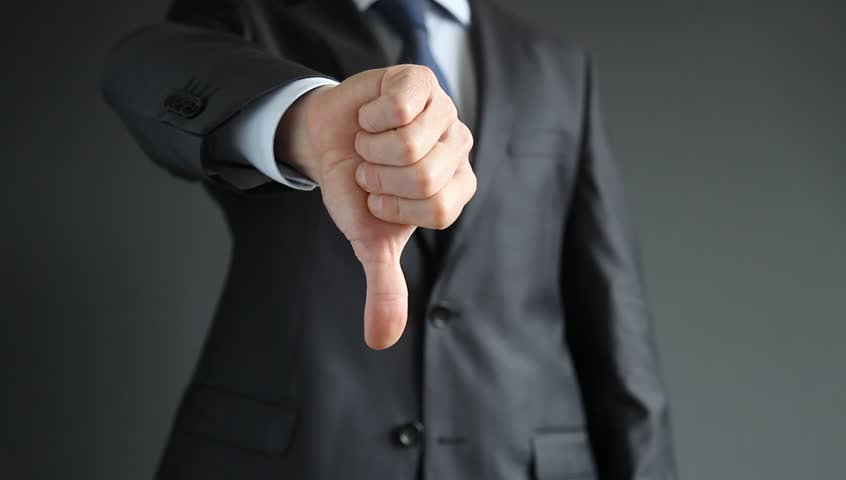 Businessman showing thumbs down - closeup shot | Shutterstock HD Video #4729889
