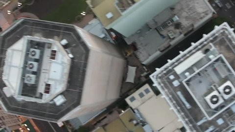 Areal shot of the top of skyscrapers and streets