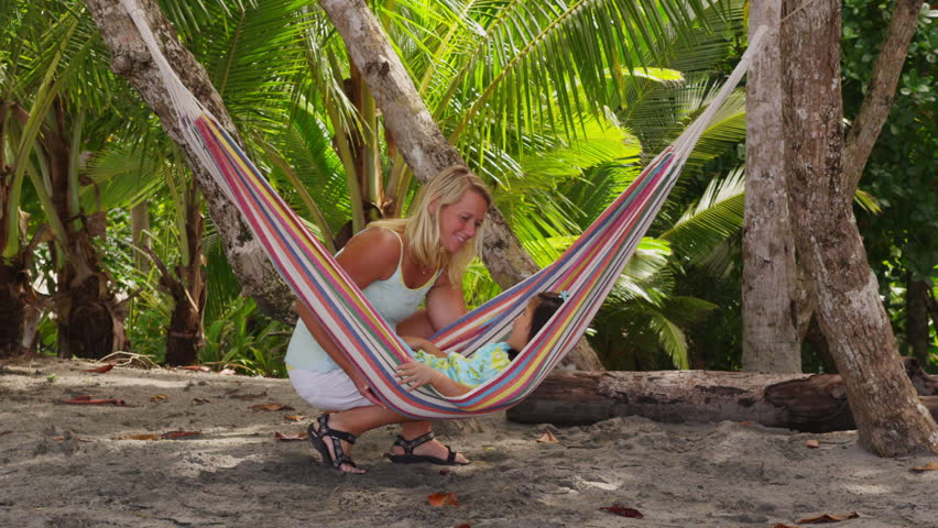 mother swings young girl in hammock at beach costa rica   hd stock video clip mother swings young girl in hammock at beach costa rica  shot on      rh   shutterstock