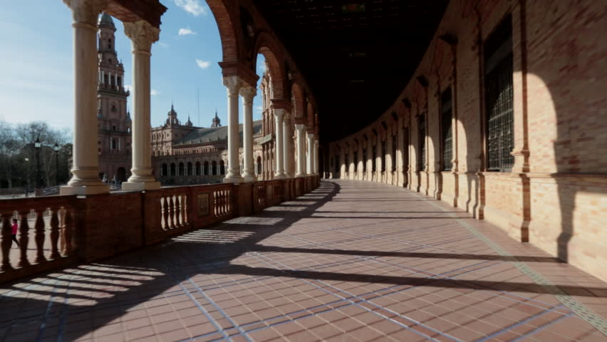 Steady cam footage sweeping down the Renaissance revival 'Plaza de Espana' in the 'Parque de Maria' (Maria Luisa Park) in Seville, Andalusia, Spain